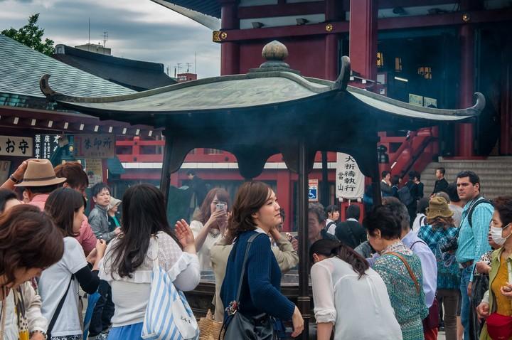 People burning incense near the Asakusa Shrine