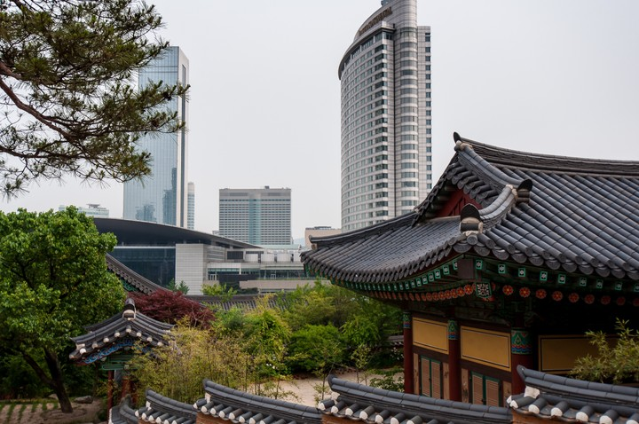 Bongeunsa Temple with skyscrapers in the background
