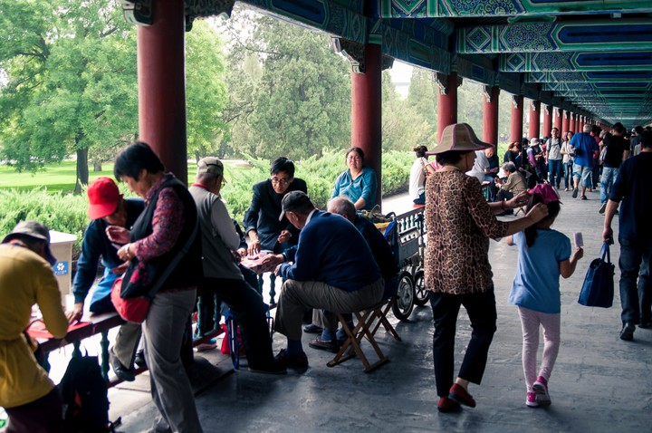 Poeple playing games in the Long corridor at the Temple of Heaven in Beijing
