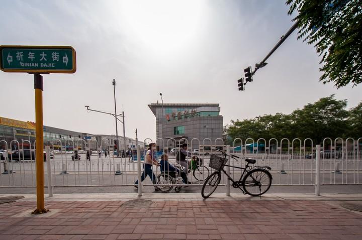 Person pushing a wheelchir on Qinian Daje in Beijing