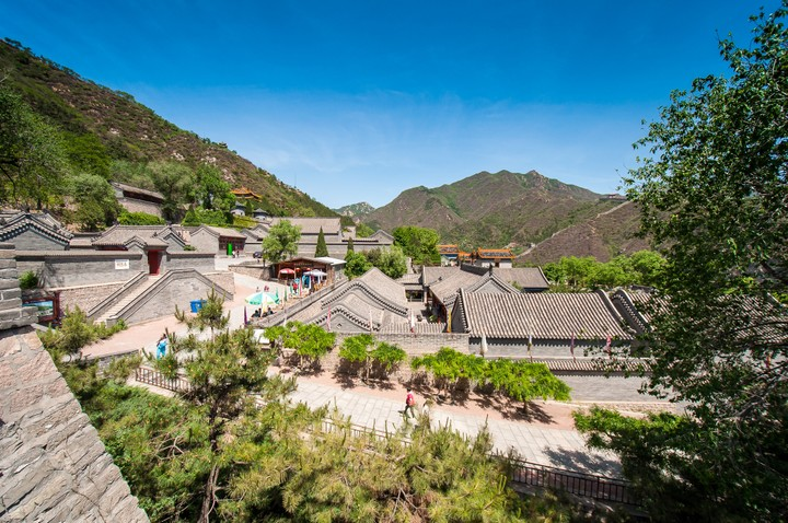 Village at the bottom of the Great Wall of China