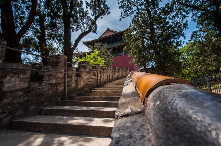 Look up the stairs towards a tower at the Emperors Tomb in Beijing