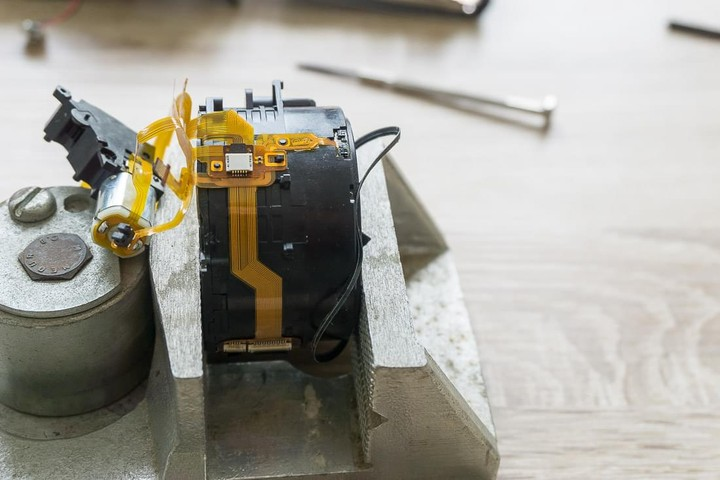 Sony RX-100 Lens assembly in vise side view