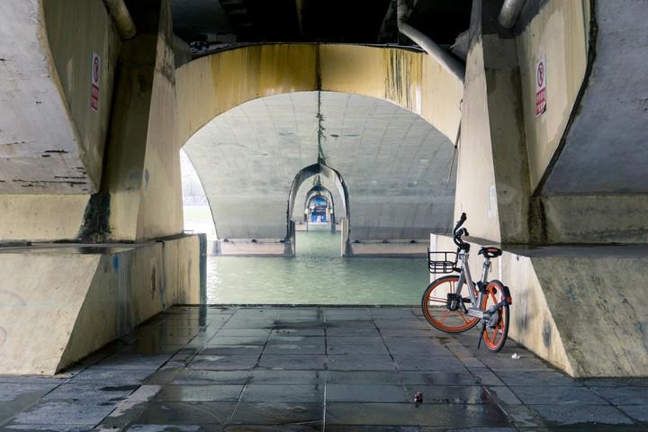 Under a bridge with a bike