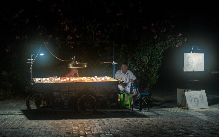 Man selling nuts in the dark