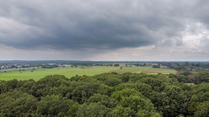 Drone shot of farmland and clouds