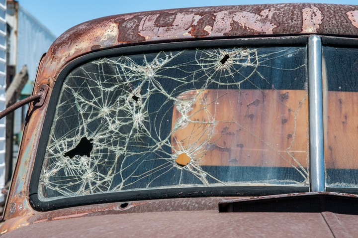 Windshield with bullet holes