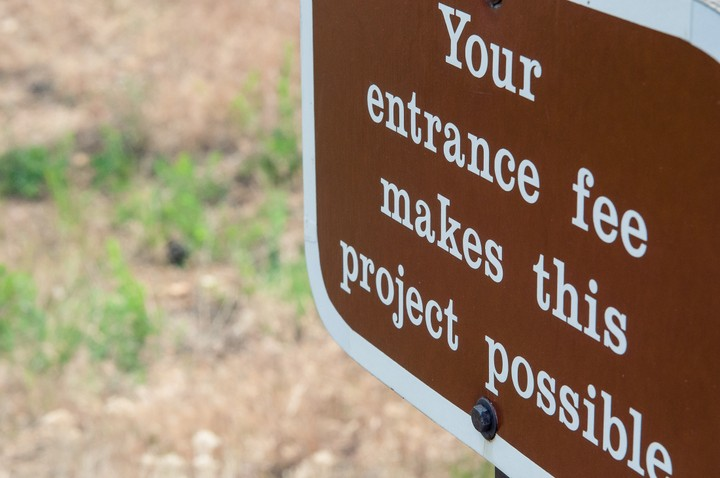 Sign that says: Your entrance fee makes this project possible