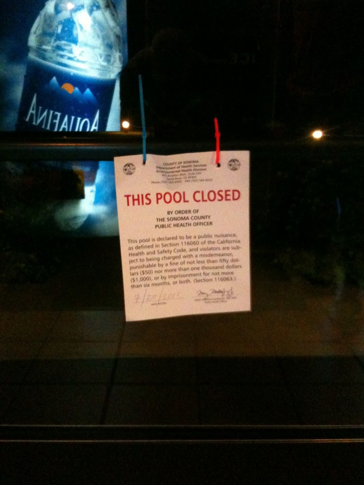 sign on door that says this pool is closed