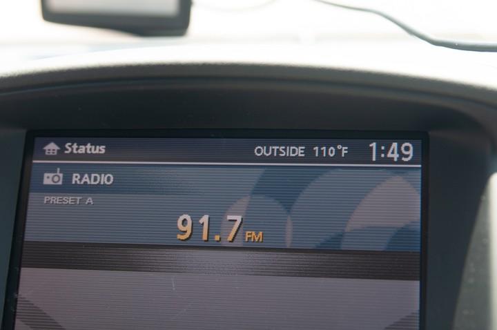 Photo of car radio showing heat of 110F
